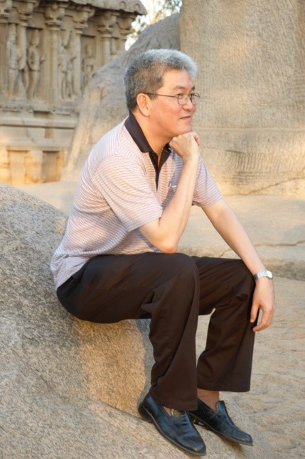 Post Indian Plaxis Advanced Course, Chennai, 2007. Professor Harry Tan posing at Shore Temple, near Chennai in Tamil Nadu